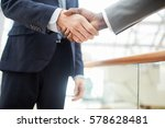 Small photo of Handshake of business leaders after negotiation