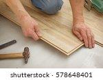 man makes laying laminated... | Shutterstock . vector #578648401