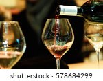 red wine pouring into a wine... | Shutterstock . vector #578684299