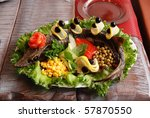 Prepared Sterlet with vegetables tasty dish - stock photo
