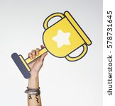 Small photo of Hand Holding Trophy Win Competition Icon