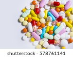 multicolored pills and tablets