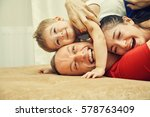 family playing with child at... | Shutterstock . vector #578763409