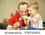 father playing with his child...   Shutterstock . vector #578763451