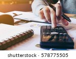 women calculate about cost and... | Shutterstock . vector #578775505