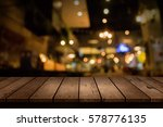 Stock photo blur coffee shop or cafe restaurant with abstract bokeh light background for create montage 578776135