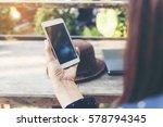 beautiful woman hands using... | Shutterstock . vector #578794345