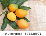 Mangoes With Leaves On Burlap