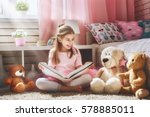 cute little kid girl is reading ... | Shutterstock . vector #578885011