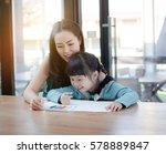 asian mother and daughter are... | Shutterstock . vector #578889847