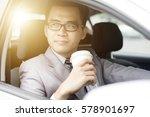 asian business man drinking... | Shutterstock . vector #578901697