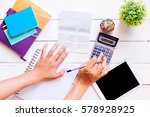 Small photo of Accountant verify the Saving Account Book and Statement of financial statements / Bookkeeping / Accountancy Concept.