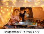 cute little children reading... | Shutterstock . vector #579011779