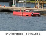 GRAVENHURST, ONTARIO, CANADA - JULY 10: Young couple driving a converted car into a boat during the annual Clssic Boat Show July 10, 2010 in Gravenhurst, Ontario,Canada - stock photo