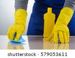 hands in rubber gloves cleaning ... | Shutterstock . vector #579053611