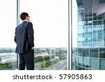 businessman looking out of his... | Shutterstock . vector #57905863