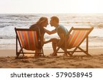man and woman are sitting in... | Shutterstock . vector #579058945