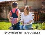 cute little boy  giving present ... | Shutterstock . vector #579098665