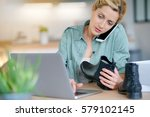 woman on the phone with... | Shutterstock . vector #579102145