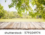 empty wooden table with garden... | Shutterstock . vector #579104974