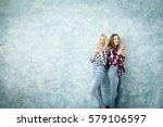 female friends using smart... | Shutterstock . vector #579106597