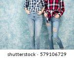 Two Female Friends In Checkere...
