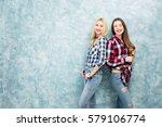 portrait of two female friends... | Shutterstock . vector #579106774