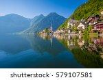 Stock photo classic postcard view of famous hallstatt lakeside town reflecting in hallstattersee lake in the 579107581