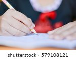 close up kid's hand writing on...   Shutterstock . vector #579108121