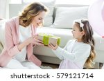 adorable little girl presenting ... | Shutterstock . vector #579121714