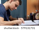 teenage boy doing homework at