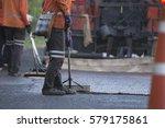 workers sweeping the street he... | Shutterstock . vector #579175861