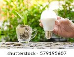 woman hand is holding led bulb...   Shutterstock . vector #579195607