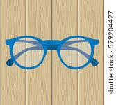 men's glasses on a wooden... | Shutterstock .eps vector #579204427
