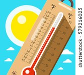 thermometer with sky and sun.... | Shutterstock .eps vector #579216025