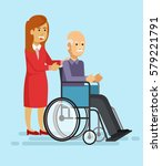 young woman helping an elderly... | Shutterstock .eps vector #579221791