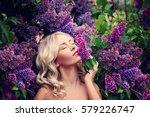 beautiful woman enjoying the... | Shutterstock . vector #579226747