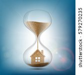 hourglass with the house inside.... | Shutterstock .eps vector #579270235
