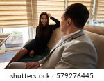 Small photo of Two asian business partners accounting data information about success of corporation