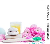 Small photo of Spa salt and stones, towel, candle, flower branch for beauty and health. Healthy relaxation, therapy and treatment. Aromatherapy, body care, aroma massage. Alternative lifestyle
