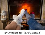 legs of couple in woolen socks... | Shutterstock . vector #579338515