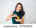 attractive asian woman eating... | Shutterstock . vector #579340699