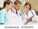 young doctors stand against a... | Shutterstock . vector #57934294