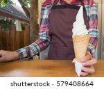 milk ice cream cone in hand of... | Shutterstock . vector #579408664