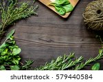 fresh herb frame on dark wooden ... | Shutterstock . vector #579440584