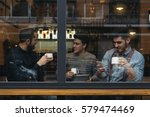 friends drinking coffee and... | Shutterstock . vector #579474469