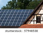 Old farm with half-timbered wall and solar panels on farm roof - stock photo