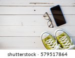 green sneaker shoes and cell... | Shutterstock . vector #579517864