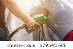 grey car at gas station being... | Shutterstock . vector #579545761