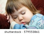 exhausted child sleeping... | Shutterstock . vector #579553861